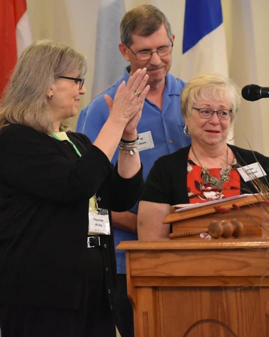 Theresa Kreig honors the Theisens