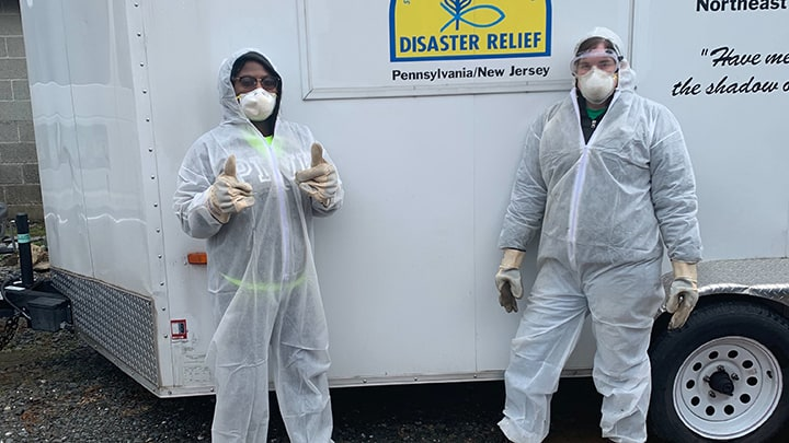 Disaster Relief Volunteers Dressed For Mud Out.