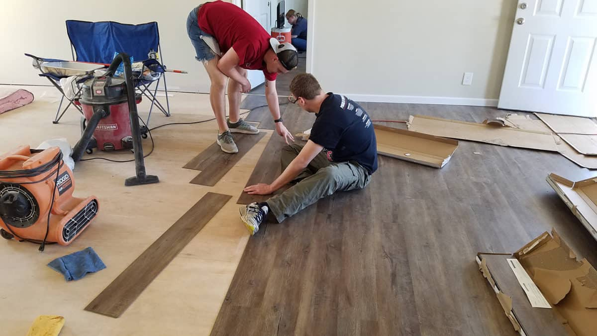 College Students Lay Flooring In A Homeowner's House That Was Ruined By Hurricane Florence.