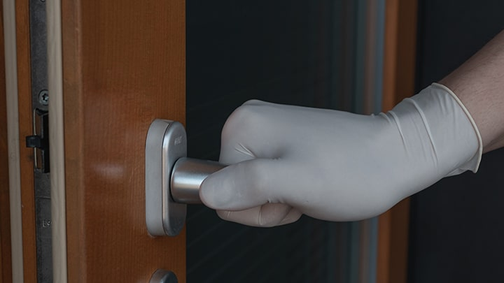 Gloved Hand Opening Door