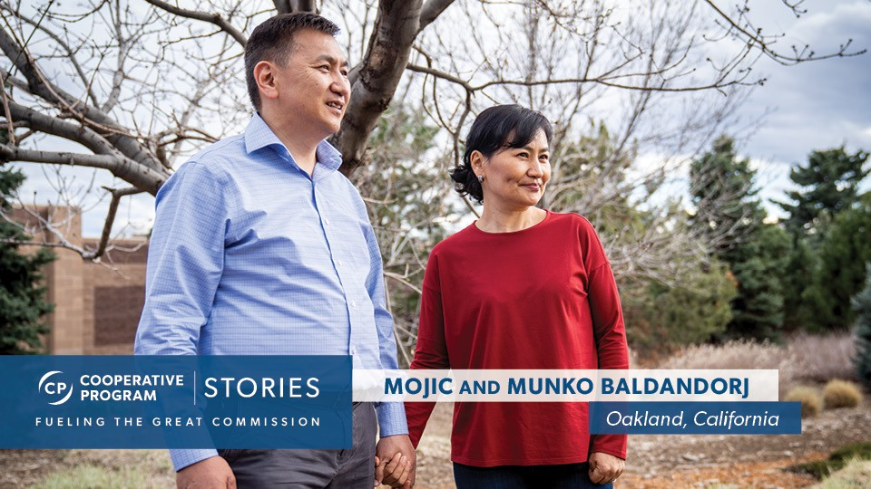 Mojic And Munko Baldandorj Holding Hands Outdoors
