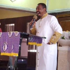 Pastor Levi Martin preaching