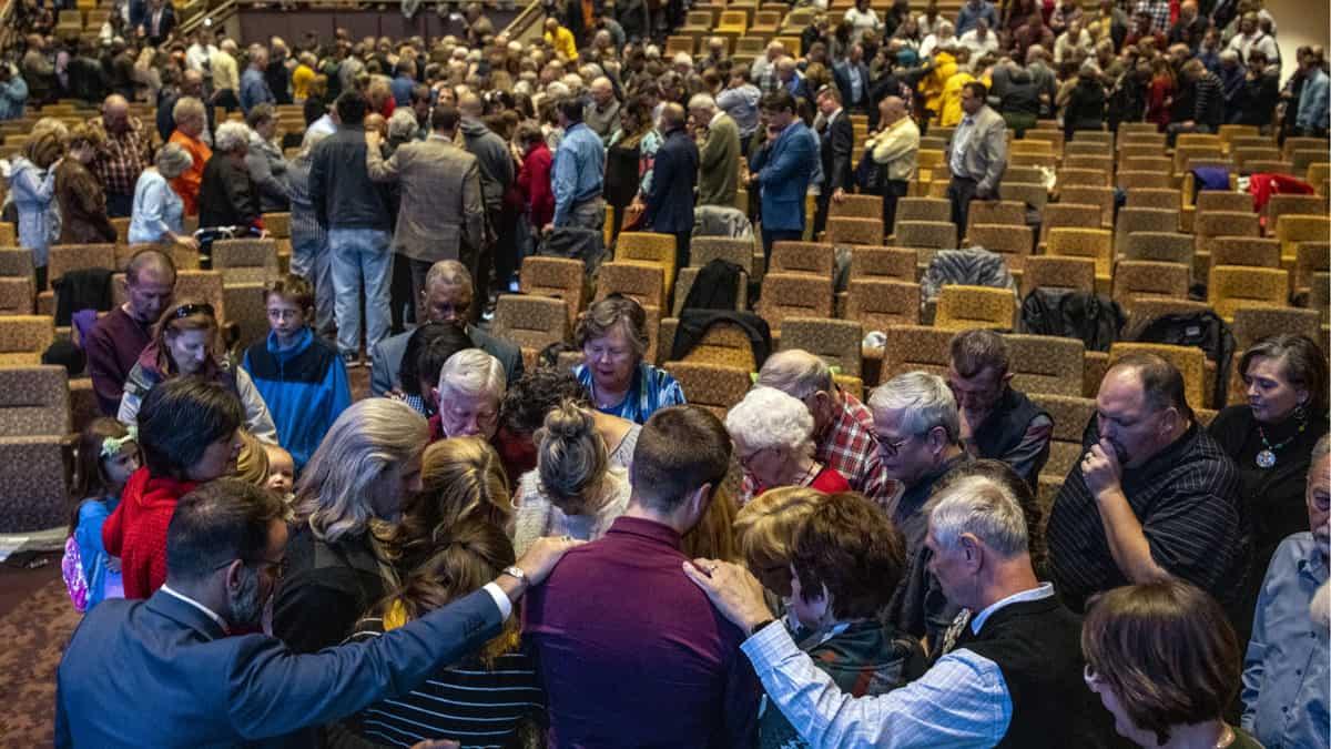 Group Praying Laying Of Hands