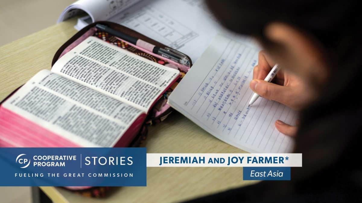 An Individual Writing Notes From Bible