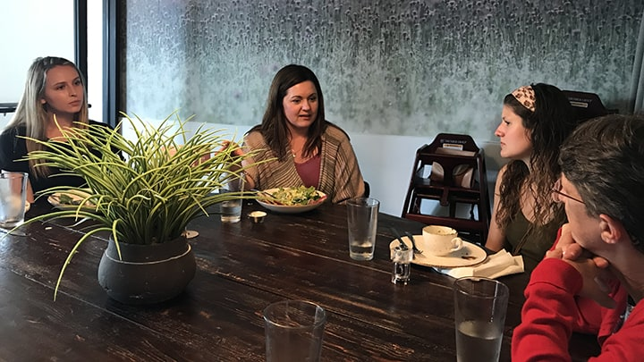 Kayla Merryman and Macala Leigey meet with a marketing professional